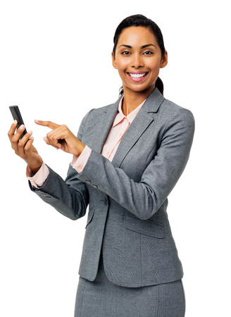 Portrait of beautiful businesswoman text messaging on smart phone over white background. Vertical shot. photo
