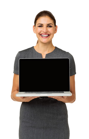 Portrait of happy businesswoman advertising laptop over white background. Vertical shot. photo