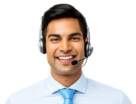 Portrait of confident businessman wearing headset against white background. Horizontal shot. photo