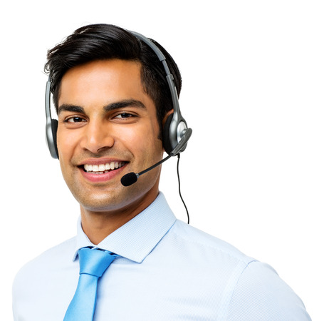 Portrait of happy male customer service representative wearing headset against white background. Horizontal shot.