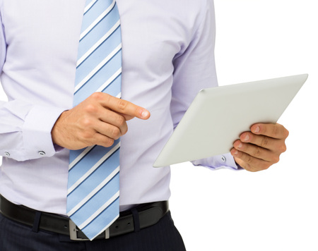 Midsection of businessman using digital tablet against white background. Horizontal shot. photo
