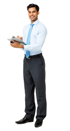 Full length portrait of confident businessman holding clipboard over white background. Vertical shot. photo