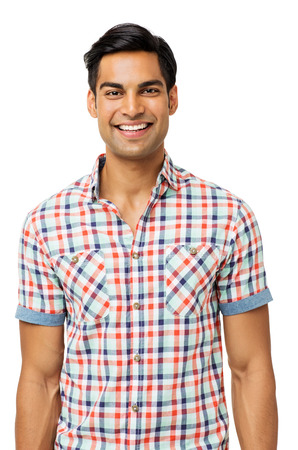 Portrait of happy young man in casuals standing against white background. Vertical shot. Stock Photo