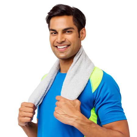 Portrait of confident young man holding towel around neck against white background. Horizontal shot. photo
