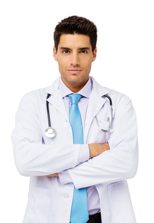 Portrait of confident male doctor standing over white background. Vertical shot.