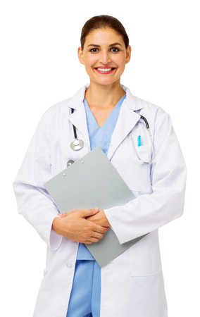 Portrait of confident mid adult doctor holding clipboard against white background. Vertical shot.