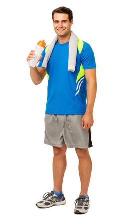 Full length portrait of happy young man drinking water after workout isolated over white background. Vertical shot. photo