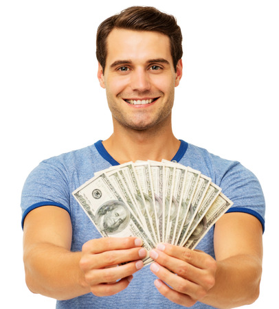 fanned: Portrait of happy young man holding fanned US paper currency isolated over white background. Horizontal shot. Stock Photo