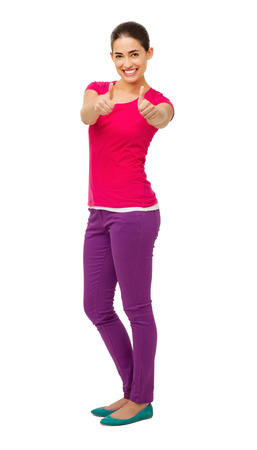 Full length portrait of young woman in casuals gesturing thumbs up with both hands over white background. Vertical shot. Stock Photo - 27276150