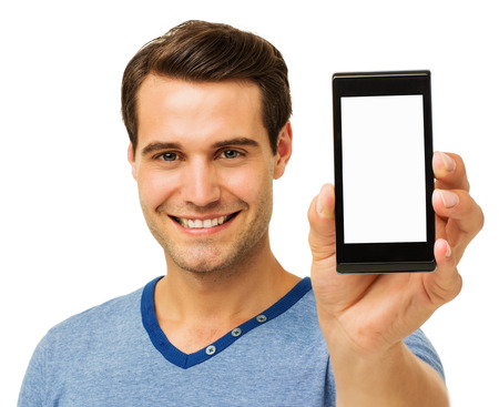 Portrait of happy man displaying smart phone against white background. Horizontal shot. Stock Photo
