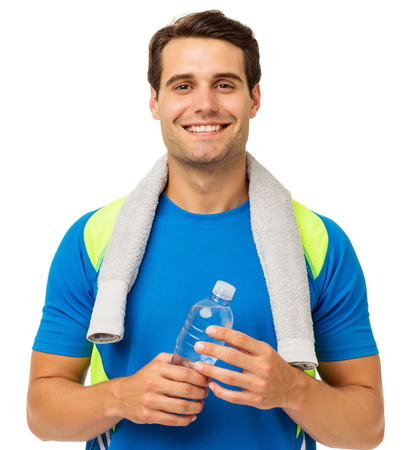 Portrait of happy young man with towel and water bottle over white background. Horizontal shot. photo