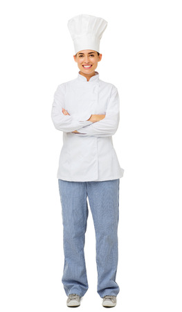 Full length portrait of happy female chef standing arms crossed isolated on white background. Vertical shot. photo