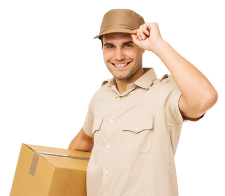 delivery service: Portrait of smiling young deliveryman carrying cardboard box over white background. Horizontal shot.