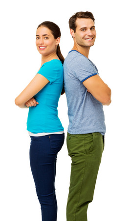 Side view portrait of happy couple with arms crossed standing over white background. Vertical shot. photo
