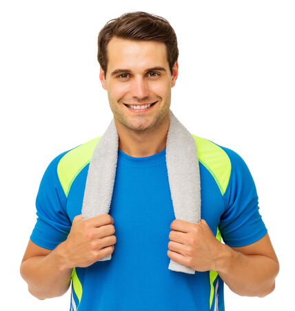 Portrait of handsome young man with towel around neck over white background. Horizontal shot. photo