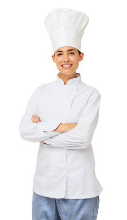 Portrait of young female chef standing arms crossed over white background. Vertical shot. photo