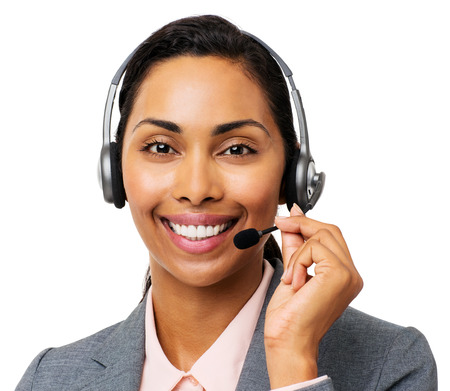 Portrait of confident female call center representative wearing headset against white background. Horizontal shot. photo