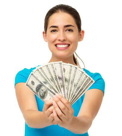 fanned: Portrait of happy young woman holding fanned US paper currency isolated over white background. Horizontal shot. Stock Photo