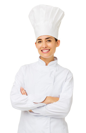 Portrait of happy female chef standing arms crossed over white background. Vertical shot. photo