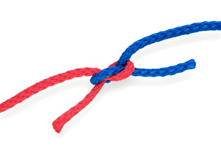 Fishers bad reef knot with red and blue ropes. Isolated on white. Tight.  photo