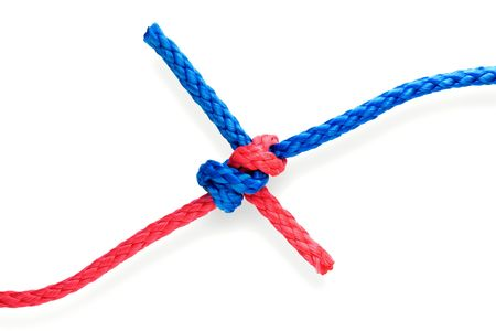 Fisher's dagger knot with red and blue ropes. Isolated on white. Tight.
