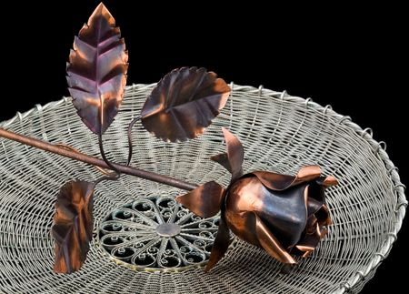 coining: Metal rose on a wattled metal tray