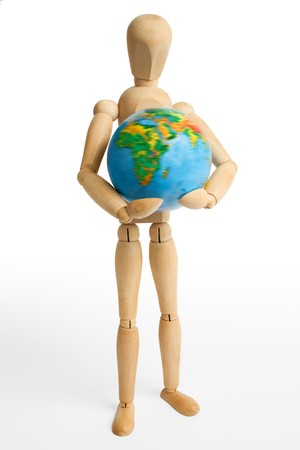 The wooden figure holds Earth. Stock Photo - 4334025