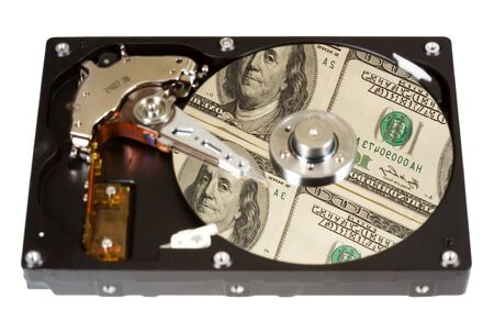 oncept: The open hard disk, reflection of dollars. Focus on dollars. �oncept information=money. Isolated on white.