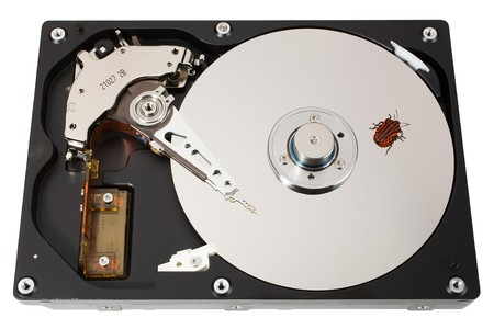 The open hard disk with one bug. �oncept of information errors. Isolated on white. photo