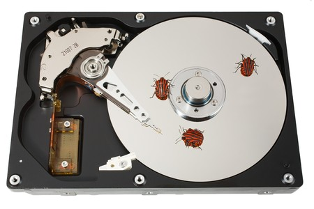 The open hard disk with three bugs. �oncept of information errors. Isolated on white. photo