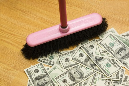 Broom, floor, heap of dollars photo