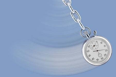 Pendulum consisting of a stop watch on a chain with movement trace  photo