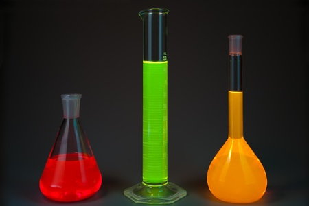 noxious: Chemical flasks with the liquids, shone different colors on a dark grey background Stock Photo