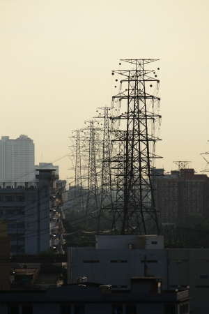Electricity pylons and lines in the city photo