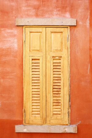 closed wooden windows in Italian style photo