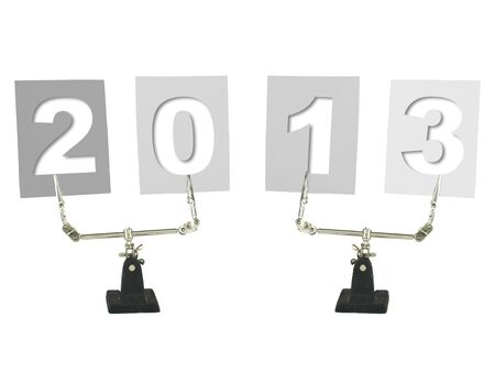 clamped: new year 2013 on clamped white note