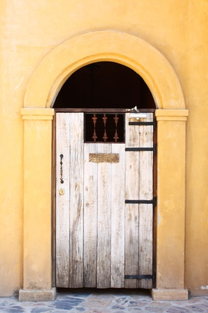 closed wooden door in Italian style photo