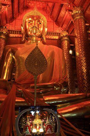 Giant golden buddha statue photo