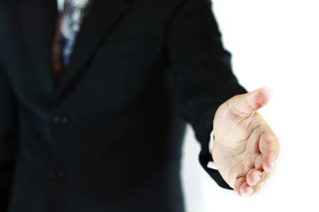 Business man with an open hand ready to seal a deal Stock Photo - 17378522