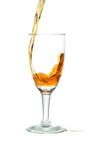 pouring whiskey into wine glass  photo