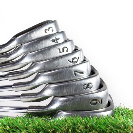 set of golf irons on the green grass Stock Photo