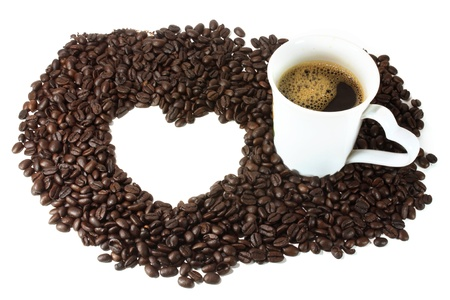 heart brown coffee beans texture frame with white coffee cup Stock Photo - 18252580