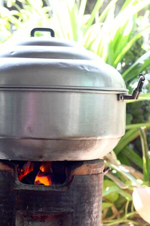 Thai traditional steaming pot on stove photo