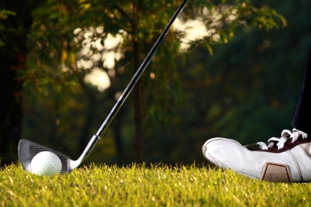 man ready to hit golf ball with golf iron Stock Photo