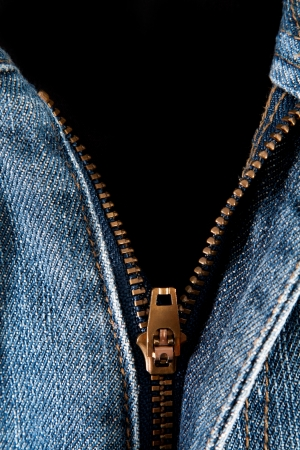 blue jeans with open zipper on black background