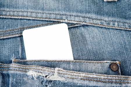blank card in blue jeans pocket photo