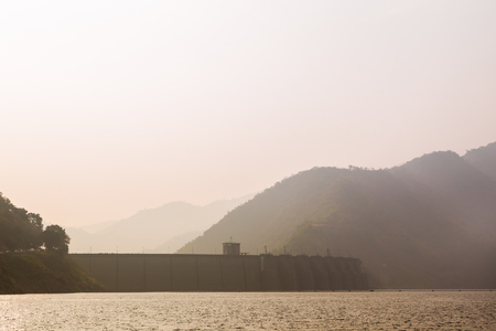 Sunset over Bhumibol dam in Thailand photo
