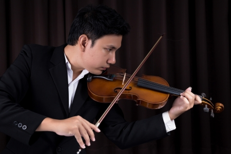 Asian man playing violin