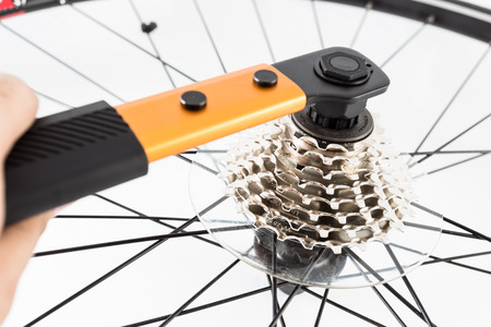 crank: hand using tools to install bicycle rear crank set