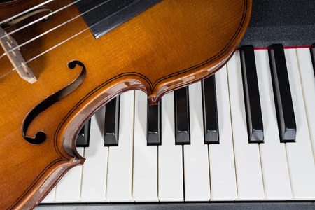 digital piano and violin photo